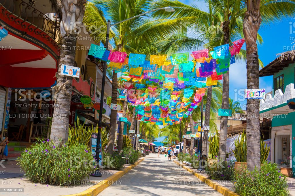 Colorful flags over street in village of Sayulita, Mexico stock photo
