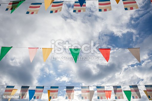 istock Colorful flags with blue sky 803906048