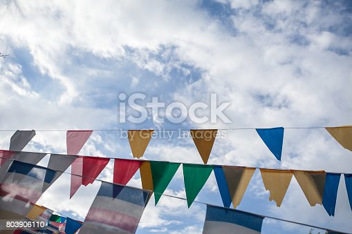 istock Colorful flags with blue sky 803906110
