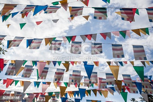 istock Colorful flags with blue sky 803906188