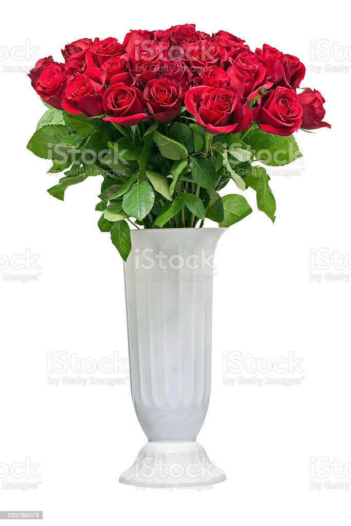 Colorful flower bouquet from red roses in white vase isolated on...