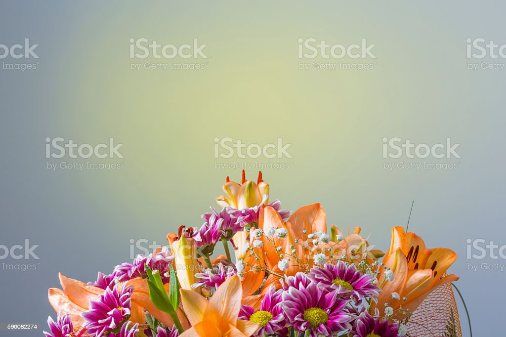 Colorful flower bouquet on a gradient yellow background royalty-free stock photo