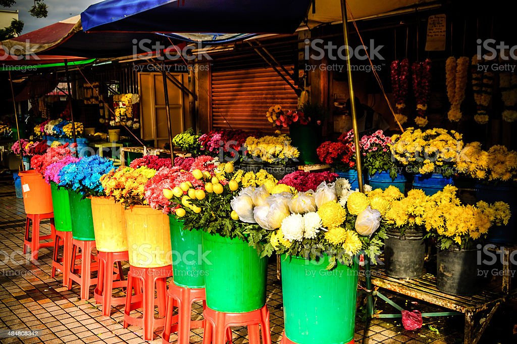 Colorful flower stall bathed in early morning sunshine stock photo