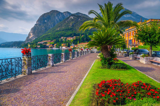 Colorful flowers and spectacular walkway, Lake Como, Menaggio, Lombardy, Italy stock photo