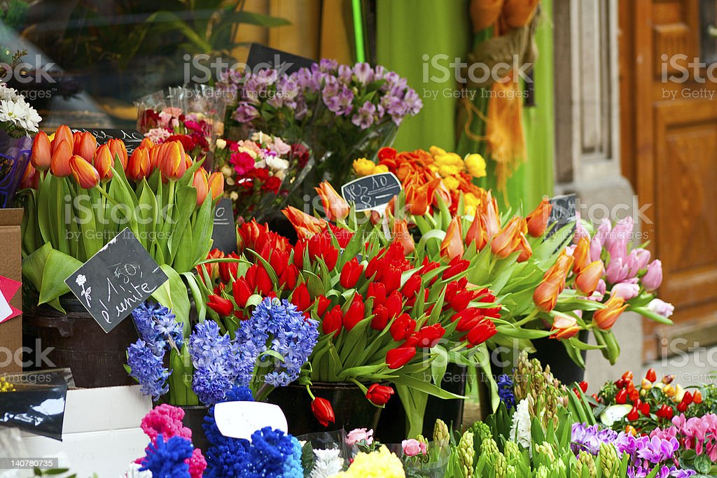 colorful flowers at street flower market stock photo