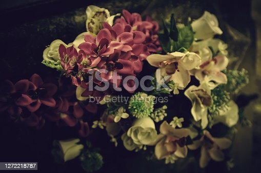 Colorful flowers in a cemetery, detail of fresh flowers, souvenir for the dead