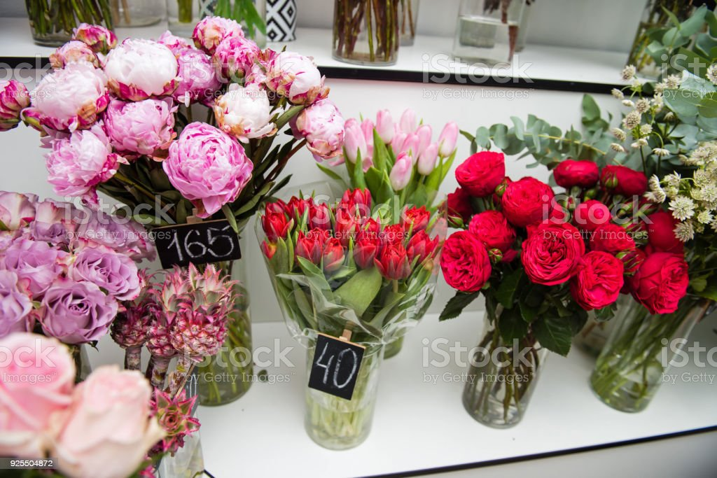 Colorful Flowers In Vases At Store Indoors Stock Photo More