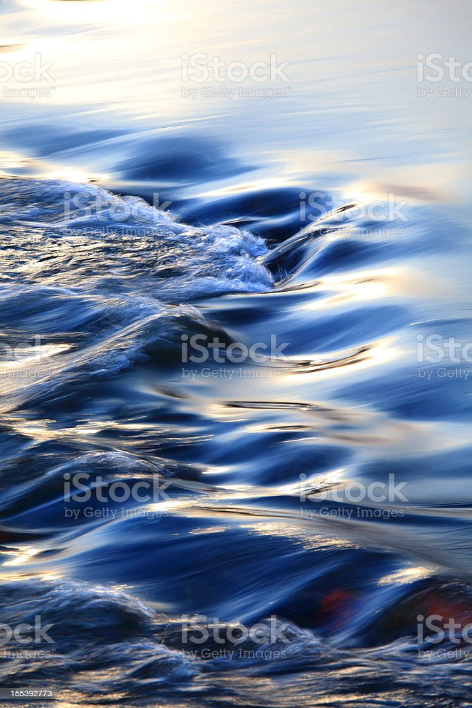 Colorful flowing water stock photo