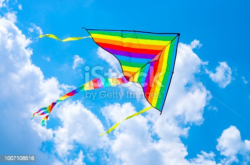 colorful flying kite flying in the sky with clouds
