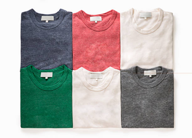colorful folded t-shirts - folded stock photos and pictures