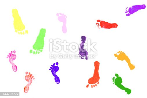 istock Colorful footprints made by actual children on white background 144797777