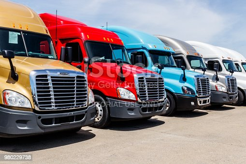 Indianapolis - Circa June 2018: Colorful Freightliner Semi Tractor Trailer Trucks Lined up for Sale. Freighliner is owned by Dailmer Trucks IV