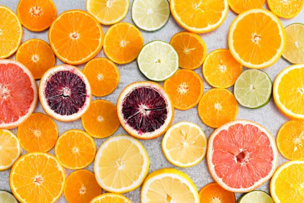 Colorful fresh cut citrus fruit background stock photo