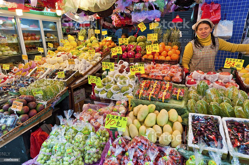 Colorful fresh fruit market stall Chinese vendor Hong Kong royalty-free stock photo