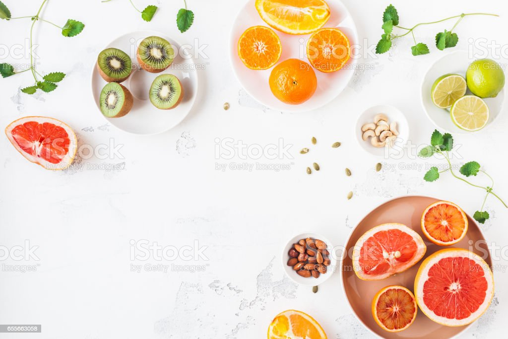 Colorful fresh fruit on white table. Flat lay, top view stock photo