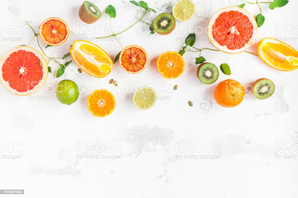 Colorful fresh fruit on white table. Flat lay, top view royalty-free stock photo