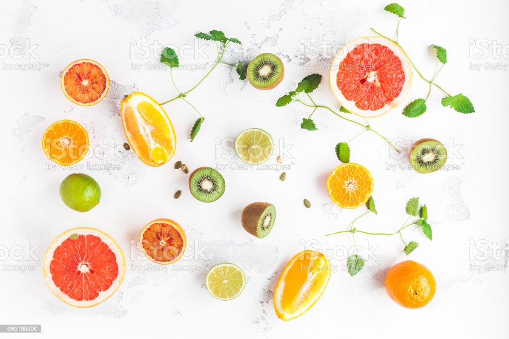 Colorful fresh fruit on white table. Fruit pattern. Flat lay royalty-free stock photo