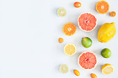 Fruit background. Colorful fresh fruits on pastel blue background. Summer concept. Flat lay, top view, copy space