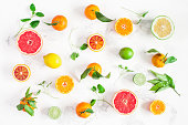 Fruit background. Colorful fresh fruits on white table. Orange, tangerine, lime, lemon, grapefruit. Flat lay, top view
