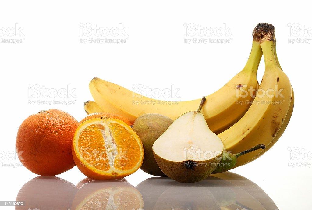 Colorful fresh organic fruit arrangement isolated on white stock photo