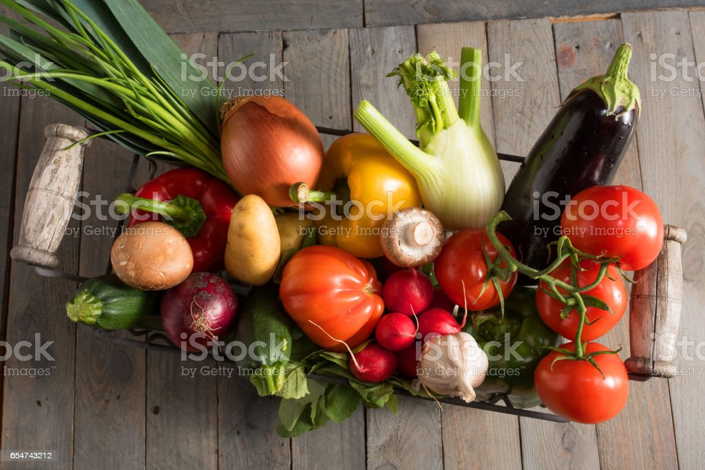 Colorful fresh vegetables in a basket Colorful fresh vegetables in a basket on a old shabby wooden table Basket Stock Photo