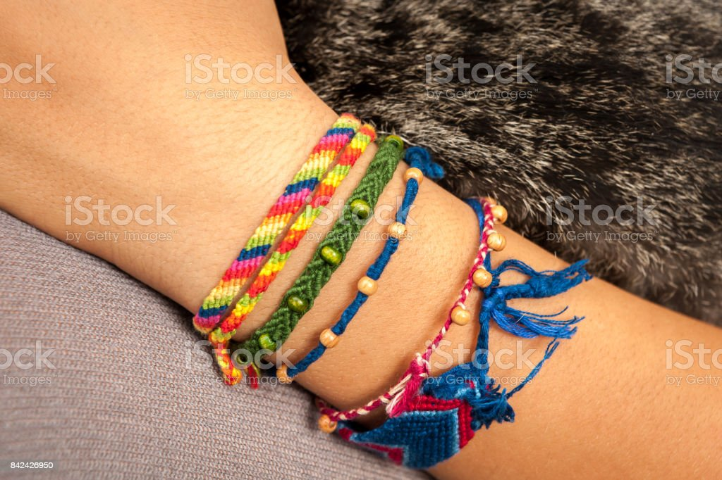 A colorful friendship bracelet on a child's hand stock photo