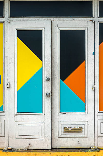 Colorful Front Doors Colorful double doors located in the South Street Sea Port district in New York City. south street seaport stock pictures, royalty-free photos & images
