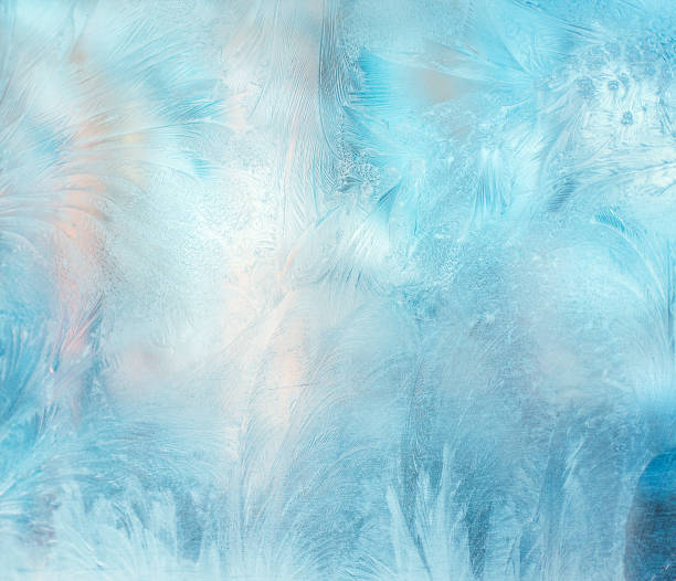 colorful frosty pattern on the window - ice crystal stock pictures, royalty-free photos & images