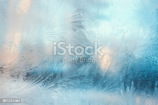 istock Colorful frosty pattern on the window 931224264