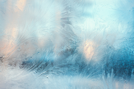 Colorful frosty pattern on the window