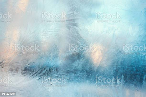 Photo of Colorful frosty pattern on the window