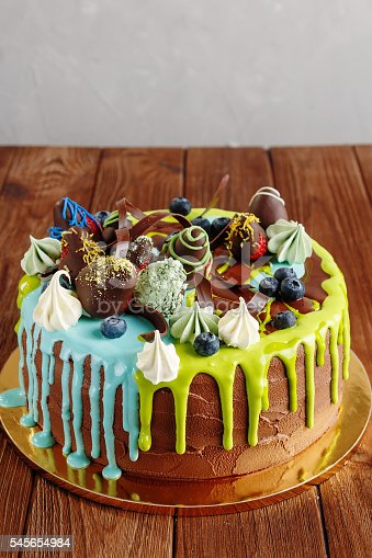 istock Colorful fruit cake for kids party 545654984