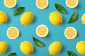 Colorful fruit pattern of lemons on blue background, top view