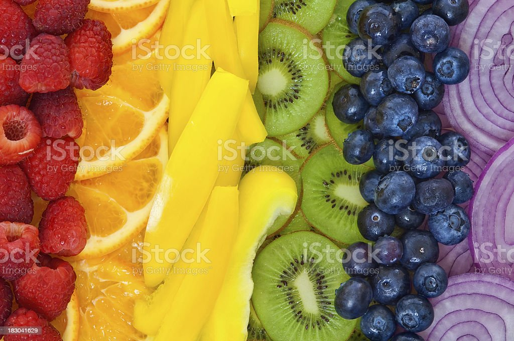 Colorful fruits and vegetables arranged in rainbow stock photo