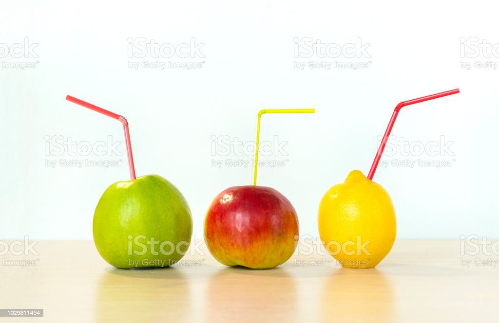 colorful fruits, fresh juicy apples, green and red Apple, yellow lemon with tubules stock photo