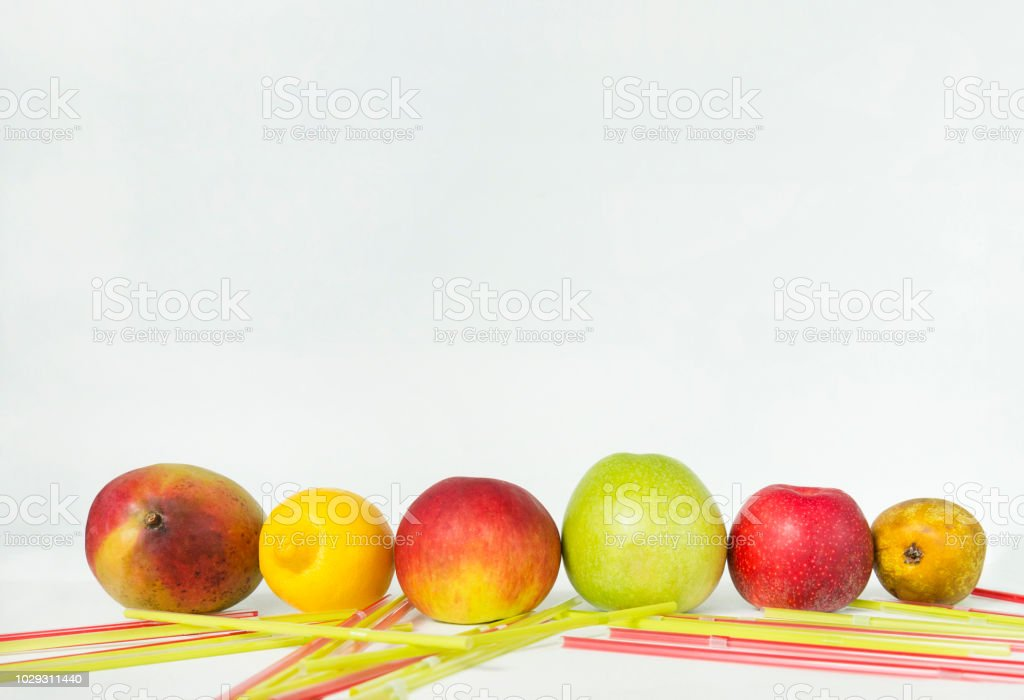 colorful fruits, red mango, yellow lemon, Apple, yellow pear, colorful cocktail tubes on white background stock photo
