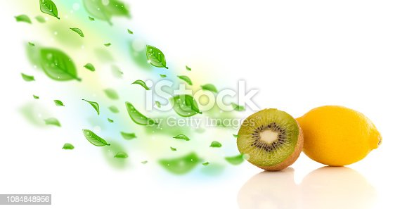 istock Colorful fruits with green organic leafs 1084848956