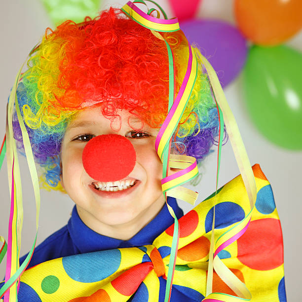 Colorful Funny Clown with Jumbo Tie, Wig and Red Nose stock photo