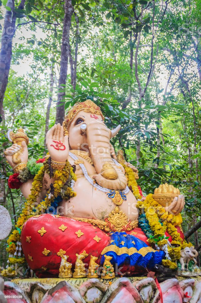 Colorful Ganesha statue in the public forest temple. Ganesha is also known as Ganapati, Vinayaka, Pillaiyar and Binayak, is one of the best-known and most worshipped deities in the Hindu pantheon. stock photo