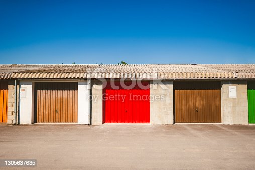 Row of colorful rusty garages or outdoor storage sheds