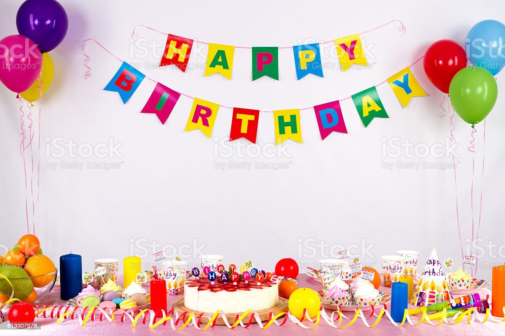 colorful garlands, streamer, party hats and confetti stock photo
