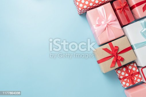 istock Colorful gift boxes on blue isolated background. 1177864038