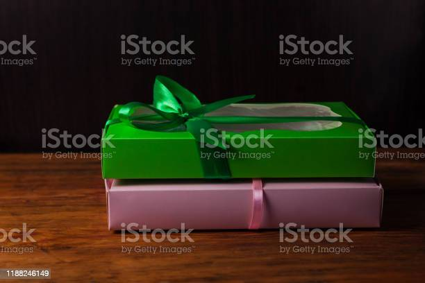 Colorful gift boxes with ribbon bows on a brown wooden background picture id1188246149?b=1&k=6&m=1188246149&s=612x612&h=fomluvlkjdhbalditn w6bwmt1zzdo3ykph7ve3e7ai=