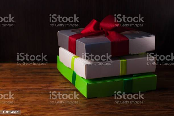 Colorful gift boxes with ribbon bows on a brown wooden background picture id1188246151?b=1&k=6&m=1188246151&s=612x612&h=np1337fppgc4nvskzebzgvhdmamnfoiklea7ouzuiqq=