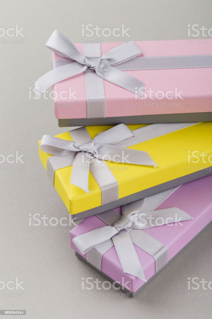 Colorful gift boxes with ribbon bows on gray background zbiór zdjęć royalty-free