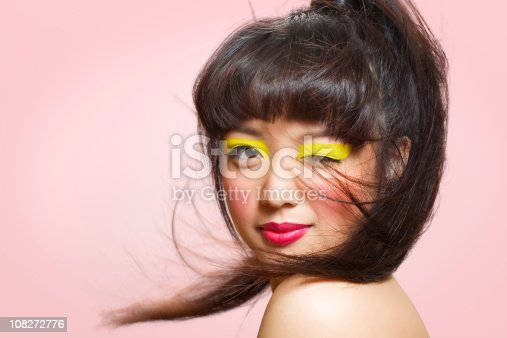 Asian model with colorful makeup.