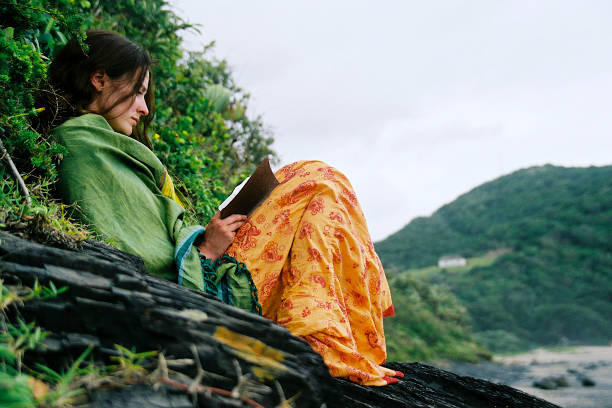 Colorful girl reading in nature stock photo