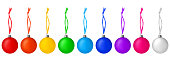 istock Colorful glass balls hanging on ribbon set white background isolated closeup, Сhristmas tree decoration collection, shiny round bauble, traditional new year holiday design element, decorative xmas toy 1260349455