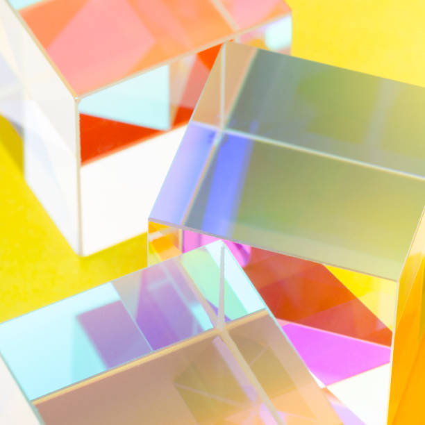 Colorful glass cubes on yellow background