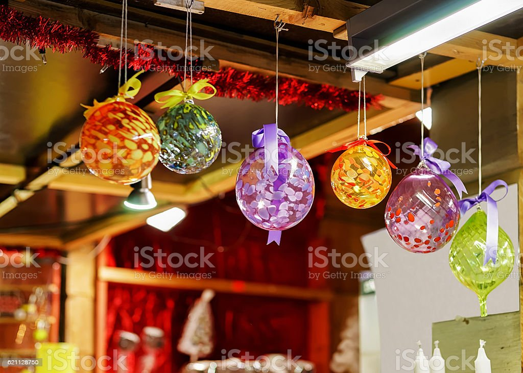 Colorful glass decorations hanging for sale at Riga Christmas market stock photo
